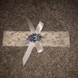 Gorgeous bridal garter. Never been worn!